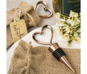 1967 Heart shaped metal bottle stopper in a Copper plated finish  in a burlap bag
